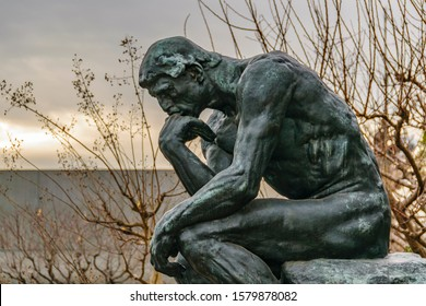 TOKYO, JAPAN, JANUARY - 2019 - Side view of bronze thinker sculpture located at western art national museum of tokyo, japan