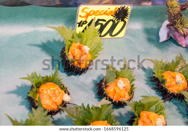 Tokyo, Japan - January 24, 2020:Fresh sea urchin eggs, also known as uni. The black uni shell has come off. You can see sea urchin eggs in a dark yellow color and eaten with wasabi.
