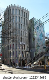 TOKYO, JAPAN - January 25, 2018: View of a street in Omotesando with the Norihiko Dan-designed Hugo Boss's flagship store and the adjacent Toyo Ito-designed Tod's store.