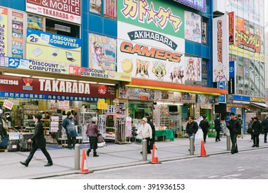 Tokyo, Japan - January 27, 2016: People walk in front of electronics and games stores in Akiharaba, Tokyo. Akihabara, is considered center of electronics goods and well-known as otaku cultural center.