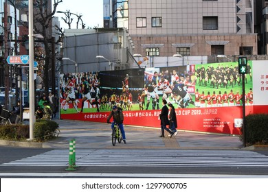 TOKYO, JAPAN - January 27, 2019: A street corner in Tokyo's Gaienmae area with a billboard advertsing the 2019 Rugby World Cup in front of a construction site.