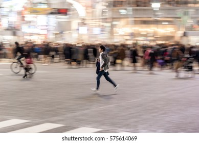 TOKYO, JAPAN - JANUARY 28, 2017: Shibuya District in Tokyo. Famous and busiest intersection in the world, Japan. Shibuya Crossing. Blurry Panning Running People.
