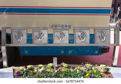 tokyo, japan - january 28 2020: Metal handprints of actors, rakugo comedians, singer and artists displayed on Orange Street of Asakusa Public Hall.