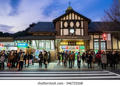 TOKYO, JAPAN - January 3, 2016: Locals and tourists waiting to cross the road in front of Harajuku Station, is an antique train station very beautiful place