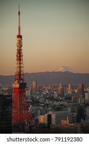 Tokyo, Japan - January 3, 2018 - Beautiful crisp clear sunrise on Tokyo Tower and Mount Fuji in Japan's capital city