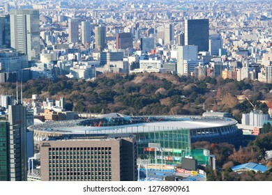 TOKYO, JAPAN - January 3, 2019:  Overhead view of the National Stadium being built for the 2020 Olympics and Tokyo's skyline at the beginning of 2019.