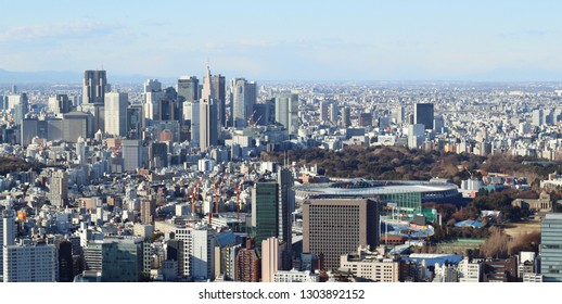 TOKYO, JAPAN - January 3, 2019:  Overhead view of Tokyo's skyline including the National Stadium being built for the 2020 Olympics and skyscrapers in Shinjuku.