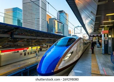 TOKYO, JAPAN - JANUARY 3: A Shinkansen train pulls into Tokyo Station on January 3, 2015 in Tokyo, Japan.
