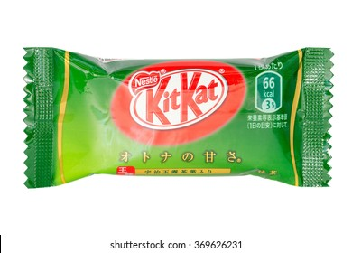 TOKYO, JAPAN - JANUARY 30, 2016: KitKat Green Tea Chololate Wafer Snack from Japan. Kit Kat bar green tea flavor isolated on white. Kit Kat is a chocolate biscuit bar confection by Nestle