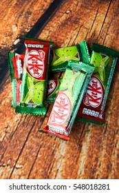 TOKYO, JAPAN - JANUARY 30, 2016: KitKat Green Tea Chololate Wafer Snack from Japan. Kit Kat bar green tea flavor isolated on white reflection. Kit Kat is a chocolate biscuit bar confection by Nestle