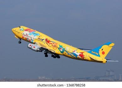"Tokyo, Japan - January 31, 2010: All Nippon Airways (ANA) Boeing B747-400D (JA8957) passenger plane. Special livery ""Pokémon Jet (Pikachu Jumbo)"" scheme."