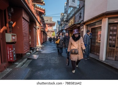 TOKYO, JAPAN - JANUARY 6TH, 2018. Tourists and visitor walking at the backstreet alley of Sensoji Temple, Asakusa.