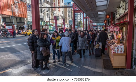 TOKYO, JAPAN - JANUARY 6TH, 2018.  Crowd of people walking in Asakusa street sidewalk.