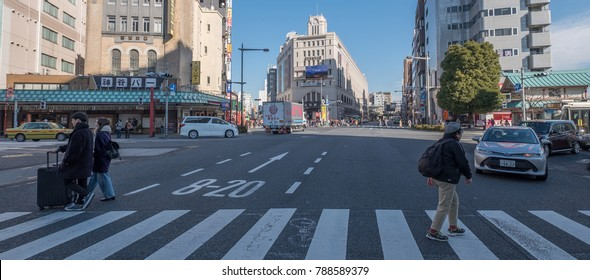 TOKYO, JAPAN - JANUARY 6TH, 2018.  People crossing Asakusa street during the day.