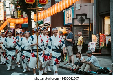 Tokyo, Japan - July 08 2019: Awa-odori dance during the Kagurazaka Matsuri (summer festival). Participants form a procession to perform a graceful traditional Japanese dance that originated in Tokushi