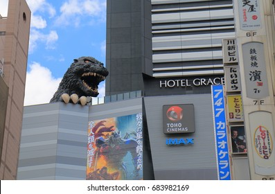 TOKYO JAPAN - JULY 11, 2017: Godzilla statue at Toho cinemas Shinjuku. TOHO Cinemas is a Japanese film, theatre production and distribution company and famous for Godzilla movies.