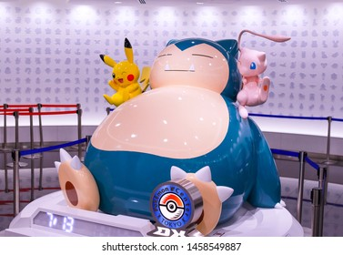 Tokyo, Japan - July 13, 2019 - Entrance area of Pokémon Center DX in Nihonbashi. There is a huge Pokémon character statue with Pikachu, Mew and Snorelax.