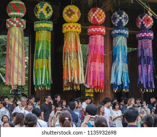 TOKYO, JAPAN - JULY 14TH, 2018. Tanabata or paper turbular streamer hanging at the entrance of Yasukini shrine during Mitama (Or Soul) Festival.