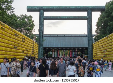 TOKYO, JAPAN - JULY 14TH, 2018. Tourists  crowd at Yasukuni Shrine entrance during Mitama (or Soul) Summer Festival.