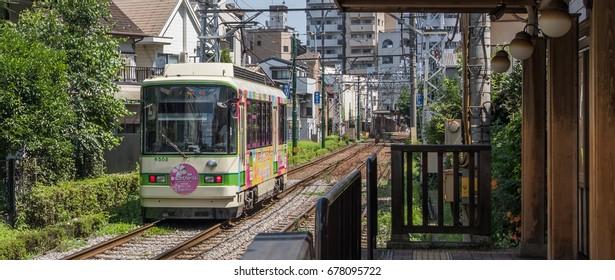 TOKYO, JAPAN - JULY 15TH, 2017. Tokyo last surviving light trail tram, Toden Arakawa line in Asakuyama neighborhood.