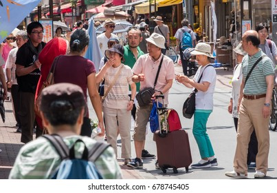TOKYO, JAPAN - JULY 15TH, 2017. People at Sugamo Jizodori shopping street. Often referred to as Grandma's Harajuku, the street is very popular with elderly people.