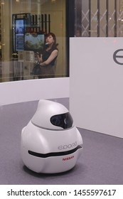 TOKYO, JAPAN - July 19, 2019: A Nissan EPORO robot cars in Nissan Crossing's showroom windo in Ginza seen in the evening.