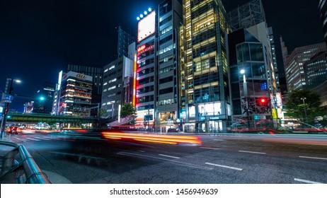 TOKYO, JAPAN - JULY 19TH, 2019. Vehicle light trails at Yurakucho Street at night. Long exposure.