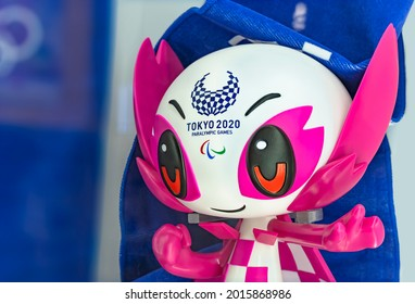 tokyo, japan - july 20 2021: Closeup on the face of a plastic figurine depicting the cute and kawaii official mascot character someity adorned with the Tokyo 2020 Paralympic Games logo.