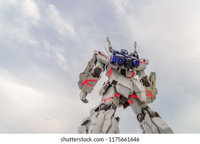Tokyo, Japan - July 2018: Back view of Real-size of the Unicorn Gundam RX-0 standing in front of the Diver City Tokyo Plaza building is landmark of Odaiba, Tokyo, JAPAN - At Night time