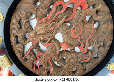 TOKYO, JAPAN -JULY, 2018: Dragon carving under big Japanese lantern hang over gate at Senso-ji buddhist temple - located in Asakusa district, Tokyo, Japan