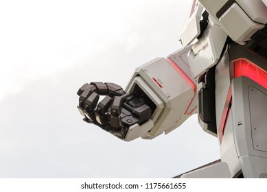 Tokyo, Japan - July 2018: Hand of Real-size of the Unicorn Gundam RX-0 standing in front of the Diver City Tokyo Plaza building is landmark of Odaiba, Tokyo, JAPAN - At Night time
