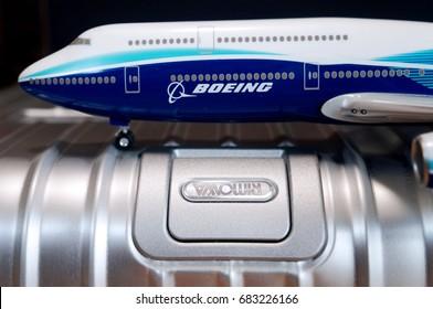 Tokyo, Japan - July 22, 2017: Photo of RIMOWA topas logo and Boeing 747-8 aircraft model.