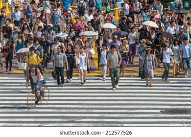TOKYO, JAPAN - July 25, 2014: The people crossing the center of Shibuya the most important commercial center in Tokyo
