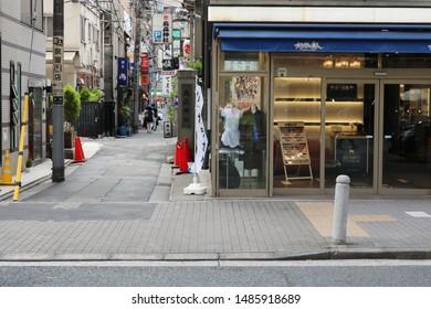 TOKYO, JAPAN - July 27, 2019: A street in Shimbashi in central Tokyo with a karaoke center, part of the Karaoke no Tetsujin chain.
