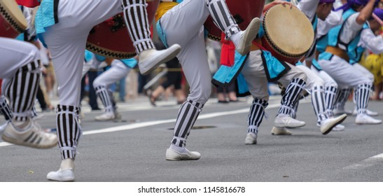 TOKYO, JAPAN - JULY 29TH, 2018. Close up view of participants leg movements while beating a taiko drums in performing their routines at Eisa Shinjuku Festival.