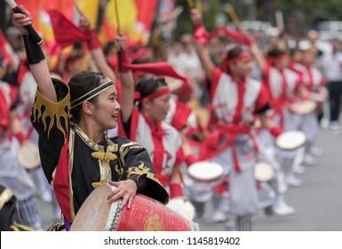TOKYO, JAPAN - JULY 29TH, 2018. Participants beating a taiko drums while performing routines at Eisa Shinjuku Festival.