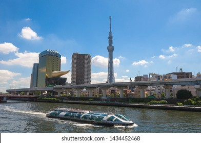Tokyo, Japan - July 30, 2016 : The Hotaluna unique boat ,Tokyo Skytree and the Asahi Tower on day.