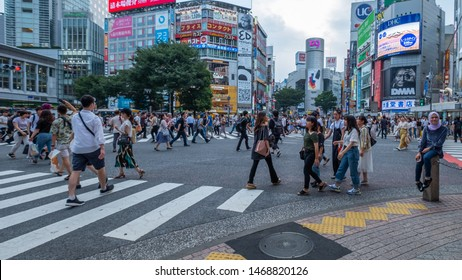 TOKYO, JAPAN - JULY 30TH, 2019. Pedestrian crowd at Shibuya scramble crossing during the day.