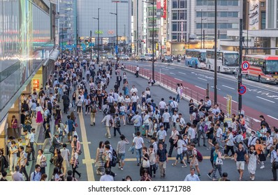 TOKYO, JAPAN - JULY 3RD, 2017. People at the sidewalk in front of Shinjuku Station. Shinjuku is a major commercial and administrative center in Tokyo Metropolitan area, Japan.