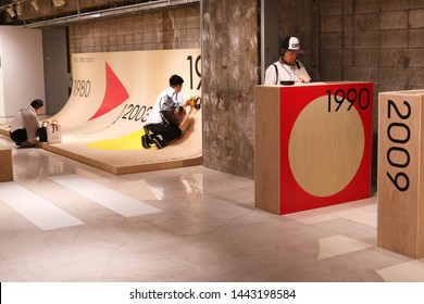 TOKYO, JAPAN - July 5, 2019: Visitors listen music using Walkman players on display at the '#009 Walkman in the Park' being exhibition held to commemorate the portable music player's 40th anniversary.