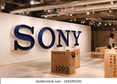 TOKYO, JAPAN - July 5, 2019: Part of Sony's '#009 Walkman in the Park' exhibition including a large Sony sign and various Walkman exhibited on wooden blocks.