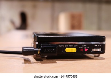 TOKYO, JAPAN - July 5, 2019: Close-up of the side of a Sony cassette Walkman, the WM-703C,  displayed at '#009 Walkman in the Park' exhibition at Ginza Sony Park, held for the Walkman's 40th birthday.
