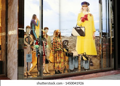 TOKYO, JAPAN - July 5, 2019: Mannequins in a Gucci store's window display. The store is located in Toyko's Ginza area.