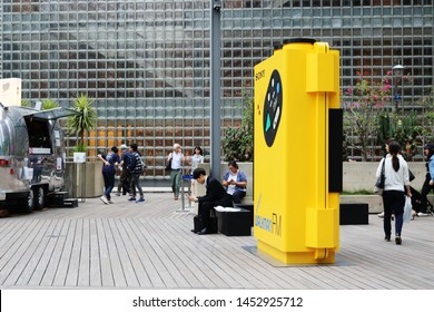 TOKYO, JAPAN - July 5, 2019: A giant model of a Sony Sports Walkman at Ginza Sony Park. It is part of the '#009 Walkman in the Park' exhibition held to commemorate the Walkman's 40th anniversary.