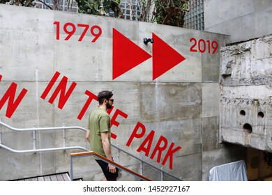 TOKYO, JAPAN - July 5, 2019: The wall by the stairs leading to the subterranean park Ginza Sony Park. It is holding '#009 Walkman in the Park' exhibition to commemorate the Walkman's 40th birthday.
