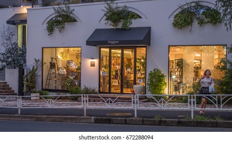 TOKYO, JAPAN - JULY 5TH, 2017. Shops in the exclusive Daikanyama district. Located just a short train ride from Shibuya, its filled with high end shops, cafes and luxury boutiques.