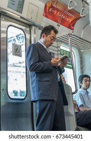 TOKYO, JAPAN - JULY 8TH 2017. Commuters in the Japan Railway Yamanote  train.