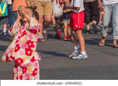 TOKYO, JAPAN - JULY 9TH, 2017. Japanese children in traditional kimono at the Kappabashi Shitamachi Tanabata annual street summer festival.