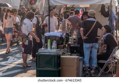 TOKYO, JAPAN - JULY 9TH, 2017. Food hawkers at the Kappabashi Shitamachi Tanabata annual street summer festival.