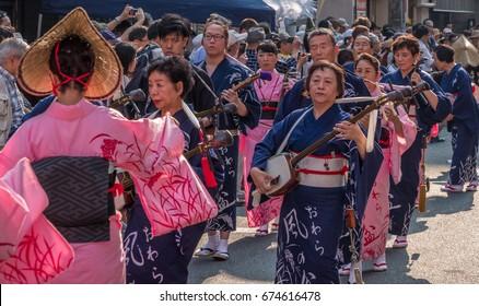 TOKYO, JAPAN - JULY 9TH, 2017.  Traditional Japanese folk musicians in kimono at the Kappabashi Shitamachi Tanabata annual street summer festival.